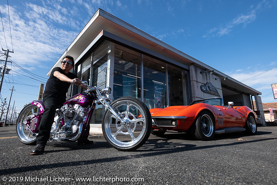 Ken Kenji Nagai of Ken's Factory in Nagoya with his new DL (Down Low) custom Shovelhead and his Corvette (formerly owned by Charlie Sheen) at his shop, Japan. Wednesday, December 5, 2018. Photography ©2018 Michael Lichter.