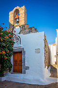 Chapel in the town of Chora on Patmos island in Greece. Patmos is a small Greek island in the Aegean Sea. One of the northernmost islands of the Dodecanese complex, it has a population of 2,998 and an area of 34.05 km2 (13.15 sq mi). The Municipality of Patmos, which includes the offshore islands of Arkoi, Marathos, and several uninhabited islets, has a total population of 3,047 and a combined land area of 45.039 square kilometres (17.390 sq mi). It is part of the Kalymnos regional unit.<br /> <br /> Patmos' main communities are Chora (the capital city), and Skala, the only commercial port. Other settlements are Grikou and Kampos. The churches and communities on Patmos are of the Eastern Orthodox tradition. In 1999, the island's historic center Chora, along with the Monastery of Saint John the Theologian and the Cave of the Apocalypse, were declared World Heritage Sites by UNESCO. The monastery was founded by Saint Christodulos. Patmos is also home to the Patmian School, a notable Greek seminary.