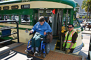 Bruce Oka disembarks the F Line Streetcar at the Ferry Building in San Francisco