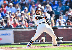 April 8, 2018 - San Francisco, California, U.S. - SAN FRANCISCO, CA - APRIL 08: San Francisco Giants Shortstop Brandon Crawford (35) leans back to avoid the ball during a regular season game between the Los Angeles Dodgers and San Francisco Giants on April 8, 2018, at AT&T Park in San Francisco, CA. (Photo by Stephen Hopson/Icon Sportswire) (Credit Image: © Stephen Hopson/Icon SMI via ZUMA Press)
