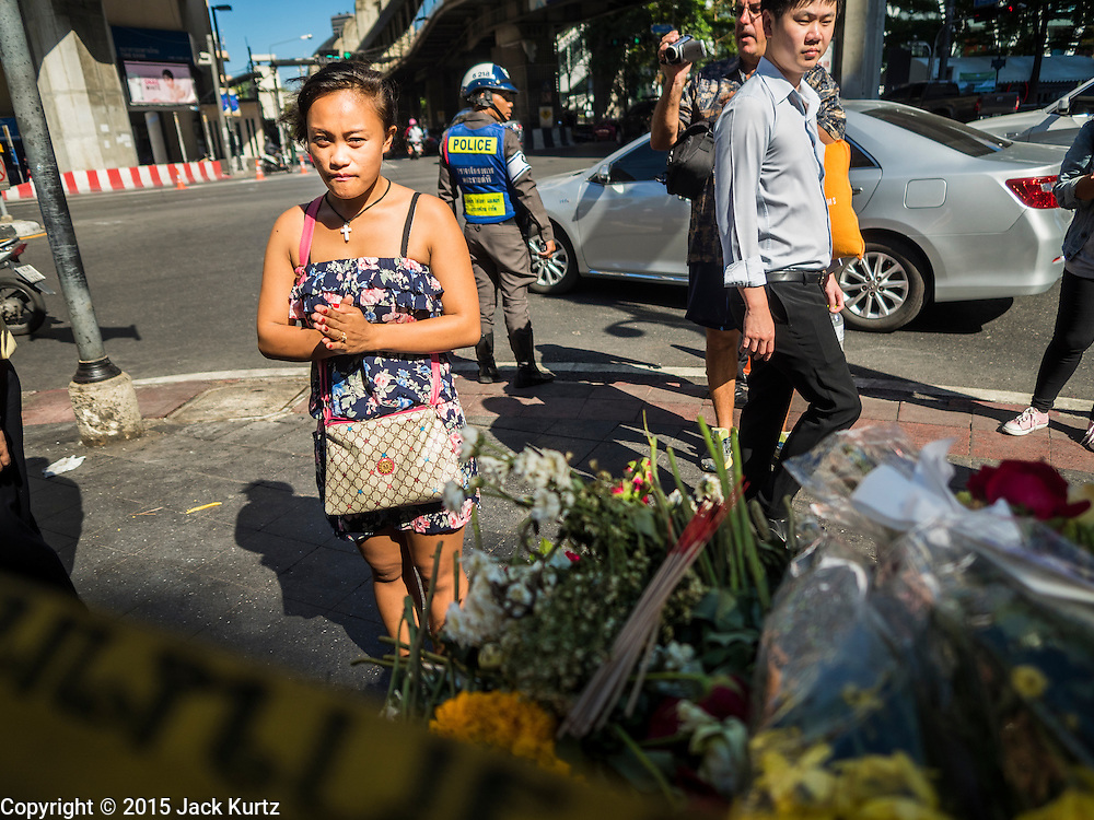 19 AUGUST 2015 - BANGKOK, THAILAND:  A woman prays in front of Erawan Shrine during the reopening of the shrine. Erawan Shrine in Bangkok reopened Wednesday morning after more than 20 people were killed and more than 100 injured in a bombing at the shrine Monday, August 17, 2015. The shrine is a popular tourist attraction in the center of Bangkok's high end shopping district and is an important religious site for Thais. No one has claimed responsibility for the bombing.     PHOTO BY JACK KURTZ