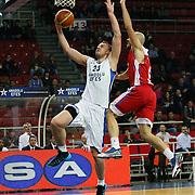 Anadolu Efes's Dusko Savanovic (L) during their Turkish Basketball League match Anadolu Efes between Tofas at the Abdi ipekci Arena in Istanbul, Turkey on Tuesday, 24 December, 2013. Photo by TURKPIX
