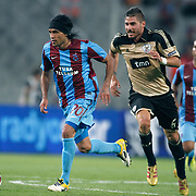 Trabzonspor's Gustavo COLMAN (L) and Benfica's Francisco FERNANDEZ (C) during their UEFA Champions League third qualifying round, second leg, soccer match Trabzonspor between Benfica at the Ataturk Olimpiyat Stadium at İstanbul Turkey on Wednesday, 03 August 2011. Photo by TURKPIX
