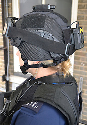 Undated handout photo issued by the Metropolitan Police of a firearms officer from the Metropolitan Police wearing a head-mounted camera, more than three years after the plans were first mooted.