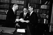 16/03/1965<br /> 03/16/1965<br /> 16 March 1965<br /> New Supreme Court Judge and New Attorney General appointed. President Eamon de Valera presenting the Warrant of Appointment to Colm Condon S.C., (right) the new Attorney General at Aras an Uachtarain. An Taoiseach Sean Lemass in the centre.
