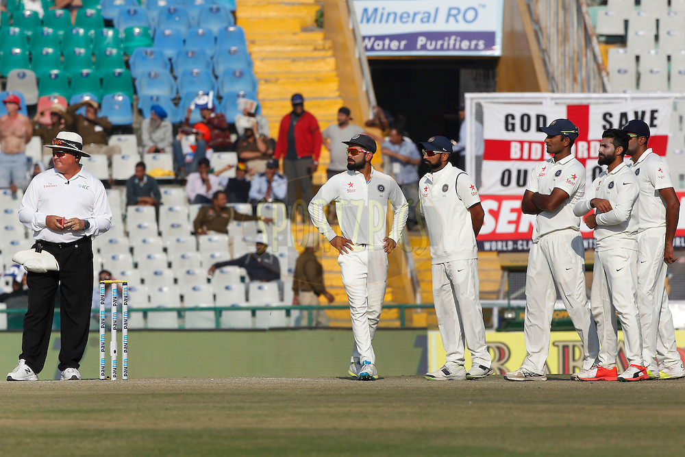 Virat Kohli Captain of India with team mates waiting for third umpire decision during day 3 of the third test match between India and England held at the Punjab Cricket Association IS Bindra Stadium, Mohali on the 28th November 2016.<br /> <br /> Photo by: Deepak Malik/ BCCI/ SPORTZPICS
