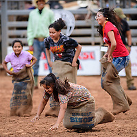 Sack races before the bull riding begins at the Wild Thing 25th Annual Championship Bull Riding competition at Red Rock Park, July 14.