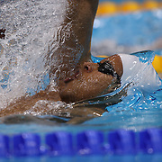 Zane Jordan, Zambia, in action in the Men's 100m backstroke heats during the swimming heats at the Aquatic Centre at Olympic Park, Stratford during the London 2012 Olympic games. London, UK. 29th July 2012. Photo Tim Clayton