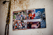 Photographs as memories at the house of Ljutvia Demyrova - a 29 years old mother of 8 children living at the local Roma community in the city of Vinica in Macedonia.