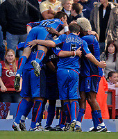 Photo: Glyn Thomas.<br />Aston Villa v Middlesbrough. The Barclays Premiership.<br />02/10/2005.<br /> Boro's Yakubu Aiyegbeni is mobbed by teammates after giving his team a 3-1 lead.