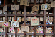 Wooden votive tablets called Ema praying  for fertility and sexual help at Kanayama Shrine during the Kanamara Matsuri, (Festival of the Steel Phallus). Kawasaki Daishi, Kanagawa, Japan. Sunday April 3rd 2016. The famous Kawasaki Penis Festival started in 1977 as a small festival to celebrate an old legend about the defeat of a penis eating demon. Today the festival is a huge draw for Japanese and foreign tourists and raises money for HIV and AIDS research.