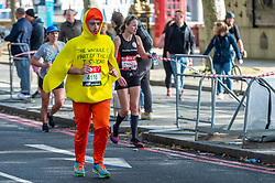 © Licensed to London News Pictures. 03/10/2021. LONDON, UK. A runner in a duck costume on Embankment passes mile 25 in the London Marathon, the first time it has been held since April 2019 due to the Covid-19 pandemic.  Over 36,000 elite athletes, club runners and fun runners are taking part in the mass event, with another 40,000 people taking part virtually.  Photo credit: Stephen Chung/LNP