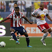 New York Red Bulls player Thierry Henry (right) and Oswaldo Minda, Chivas, USA, in action during the New York Red Bulls V Chivas USA Major League Soccer match at Red Bull Arena, Harrison, New Jersey, 23rd May 2012. Photo Tim Clayton