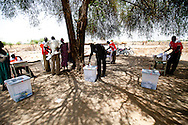 """A returning """"lost boy"""" votes in Sudan's historic elections in Bor."""