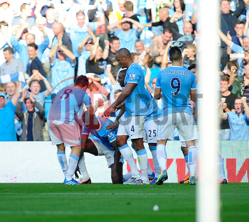 Manchester City's Yaya Toure celebrates his goal. - Photo mandatory by-line: Dougie Allward/JMP - Tel: Mobile: 07966 386802 22/09/2013 - SPORT - FOOTBALL - City of Manchester Stadium - Manchester - Manchester City V Manchester United - Barclays Premier League