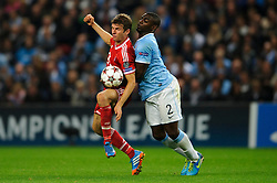 Bayern Midfielder Thomas Muller (GER) is challenged by Man City Defender Micah Richards (ENG) during the second half of the match - Photo mandatory by-line: Rogan Thomson/JMP - Tel: Mobile: 07966 386802 - 02/10/2013 - SPORT - FOOTBALL - Etihad Stadium, Manchester - Manchester City v Bayern Munich - UEFA Champions League Group D.