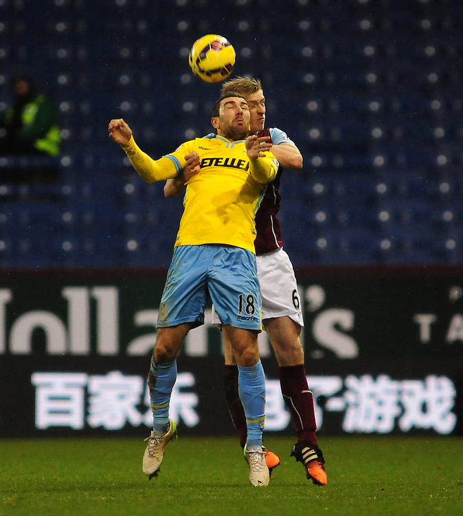 Crystal Palace's James McArthur vies for possession with Burnley's Ben Mee<br /> <br /> Photographer Chris Vaughan/CameraSport<br /> <br /> Football - Barclays Premiership - Burnley v Crystal Palace - Saturday 17th January 2015 - Turf Moor - Burnley<br /> <br /> © CameraSport - 43 Linden Ave. Countesthorpe. Leicester. England. LE8 5PG - Tel: +44 (0) 116 277 4147 - admin@camerasport.com - www.camerasport.com