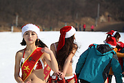 XUCHANG, CHINA - DECEMBER 23: (CHINA OUT) <br /> <br /> Christmas girls ski in a world of ice and snow on December 23, 2014 in Xuchang, Henan province of China. Christmas girls celebrated the upcoming Christmas Day by skiing in Xuchang on Tuesday, in bikini santa outfits<br /> ©Exclusivepix Media