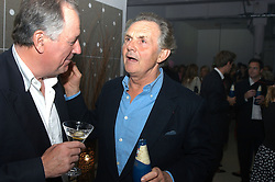 Left to right, JONATHAN AGNEW and LORD HINDLIP at an exhibition of work by Rolf Sachs - a unique world-renowned contemporary furniture designer, held in association with the Louisa Guinness Gallery and held at 250 Brompron Road, London on 6th October 2004.<br /><br />NON EXCLUSIVE - WORLD RIGHTS