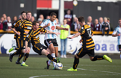 Alloa Athletic's Stephen Simmons in on Hearts Osman Sow.<br /> half time : Alloa Athletic 0 v 0 Hearts, Scottish Championship played at Recreation Park, Alloa.