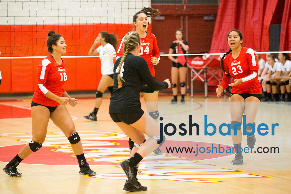 Shae Diaz, Kara Turtzer, Kaleigh Hassett, Brittney Pinzon during a non-league girl's volleyball match between the Canyon Comanches and Rosary Royals at Rosary Academy on Thursday, September 17, 2015 in Fullerton, California.
