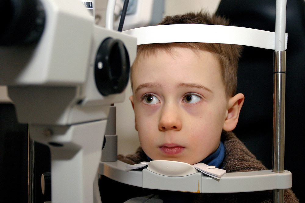 Young boy having and eye test, London