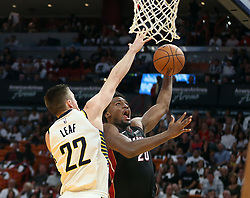 October 21, 2017 - Miami, FL, USA - The Miami Heat's Justise Winslow goes to the basket against the Indiana Pacers' T.J. Leaf (22) in the second quarter at AmericanAirlines Arena in Miami on Saturday, Oct. 21, 2017. The Heat won, 112-108. (Credit Image: © Pedro Portal/TNS via ZUMA Wire)