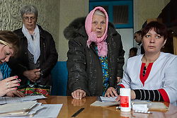 Patients attending the MSF mobile clinic in the village of Gorodishe wait to have their prescriptions fullfilled by local polyclinic staff Yelena (r) and Yulya (l).
