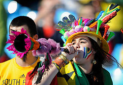 A soccer fan blows the vuvuzela as she waits for the start of the 2010 World Cup Group D soccer match between  Serbia and Ghana at Loftus Versfeld stadium in Pretoria June 13, 2010. REUTERS/Dylan Martinez  (SOUTH AFRICA  - Tags: SPORT SOCCER WORLD CUP)