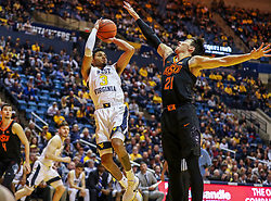 Jan 12, 2019; Morgantown, WV, USA; West Virginia Mountaineers guard James Bolden (3) shoots a jumper during the second half against the Oklahoma State Cowboys at WVU Coliseum. Mandatory Credit: Ben Queen-USA TODAY Sports