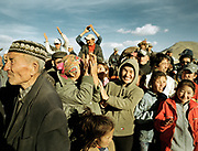 An excited Mongolian crowd cheers to the best competitors...<br /> <br /> Eagle Hunting festival in Western Mongolia, in the province of Bayan Olgii. Mongolian and Kazak eagle hunters come to compete for 2 days at this yearly gathering. Mongolia