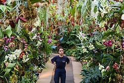 © Licensed to London News Pictures. 06/02/2020. London, UK. Kew apprentice ALICE McKEEVER looks at 'Nepenthes tobacco' during press preview of the 25th Kew Orchid Festival at Kew Royal Botanical Gardens. This year's theme is around the wonders of Indonesia and the festival runs from 8 February to 8 March 2020. Photo credit: Dinendra Haria/LNP