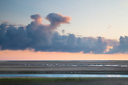 An interesting dawn sky at low tide, Wells-next-the-Sea. Norfolk Norfolk coast, East Anglia.