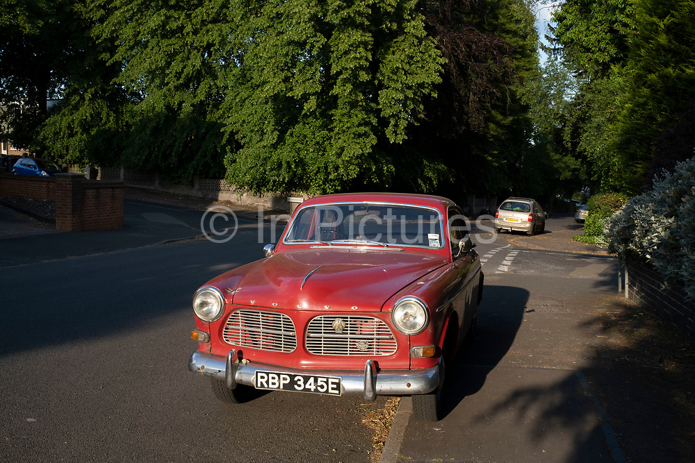 Vintage Volvo car parked on a leafy street on 1st June 2020 in Birmingham, United Kingdom. Volvo Cars, is a Swedish luxury automobile company known for producing safe and sturdy cars.