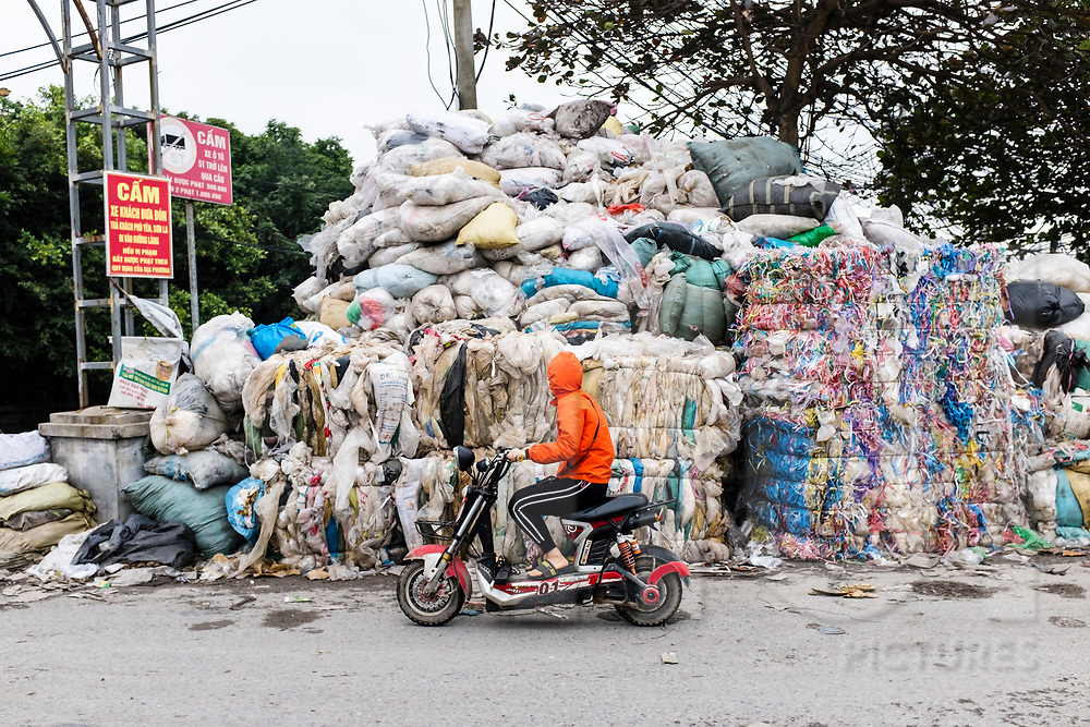 Stack of sorted plastics ready to be recycled in Minh Khai village, Hung Yen Province, Vietnam, Southeast Asia