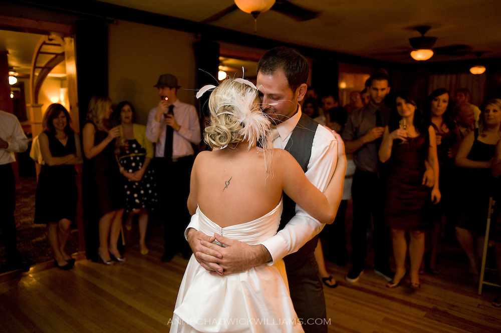 A bride and groom share their first dance after being married at Forest House Lodge in Foreshill, CA.