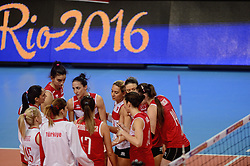 09-01-2016 TUR: European Olympic Qualification Tournament Turkije - Italie, Ankara<br /> De strijd om de tweede Japan ticket wordt gewonnen door Italie. Turkije verliest in de 5de set met 13-15 / Kubra Akman #5 of Turkey, Neslihan Demir Guler #17 of Turkey, Naz Aydemir Akyol #11 of Turkey