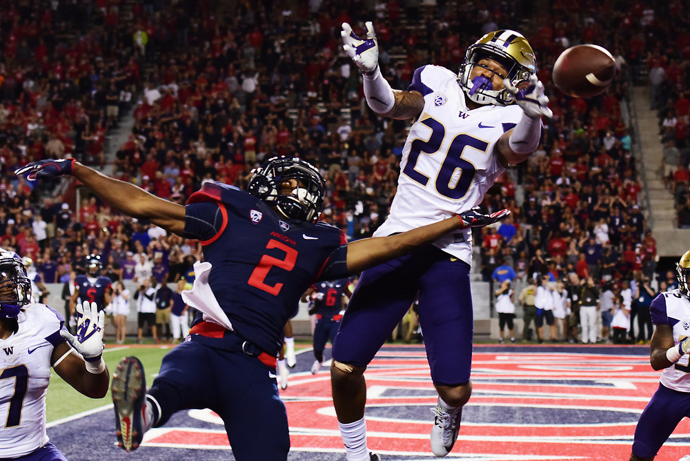 Arizona wide receiver Tyrell Johnson (2) helplessly watches as the game-tying pass flies out of reach due to Washington cornerback Sidney Jones (26), solidifying Arizona's 35-28 overtime loss to Washington at Arizona Stadium in Tucson, Arizona on Saturday, Sept. 24, 2016. (Rebecca Noble/The Daily Wildcat)