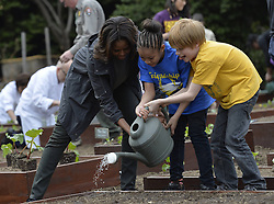 61337995<br /> U.S. First Lady Michelle Obama plants with school children in the White House Kitchen Garden on the South Lawn of the White House in Washington D.C., capital of the United States, April 2, 2014. U.S. First Lady Michelle Obama joined FoodCorps leaders and local students to plant the White House Kitchen Garden for the sixth year in a row, USA,  Wednesday, 2nd April 2014. Picture by  imago / i-Images<br /> UK ONLY