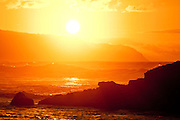 Setting sun and surf on Oahu's famed North Shore