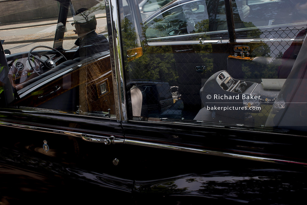 A view through the window of one of the Queen's Rolls-Royce's during the annual Royal Ascot horseracing festival in Berkshire, England. Royal Ascot is one of Europe's most famous race meetings, and dates back to 1711. Queen Elizabeth and various members of the British Royal Family attend. Held every June, it's one of the main dates on the English sporting calendar and summer social season. Over 300,000 people make the annual visit to Berkshire during Royal Ascot week, making this Europe's best-attended race meeting with over £3m prize money to be won.