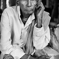 An under-nourished man waits in line outside the out-patients clinic at the JSS hospital in Ganiyari. The out-patient clinics at the JSS hospital are over subscribed. Many patiens will wait two or three days before being seen by a doctor. <br /> <br /> The JSS (Jan Swasthya Sahyog or People's Health Support Group) is a public-health initiative established in 1996 by a handful of committed doctors, all of whom trained at elite medical schools in India. While many of their peers secured high profile, high earning posts in premier hospitals in India, the US and the UK, the doctors at JSS provide a service for poor and marginalised rural communities in Bilaspur district in the eastern India.<br /> <br /> The JSS operate out of a hospital in Ganiyari, near Bilaspur. Relying on grants and donations, the JSS provide a first-class service for a community that would otherwise rely on underfunded and poorly resourced government facilities. Though JSS hospital boasts 30 beds, two operating theatres, a fully-equipped lab and three outpatient clinics a week, the service provided by JSS is over-subscribed by a community of 800,000 people from 1,500 villages. <br /> <br /> To address the malnutrition, the JSS offers training on new agricultural techniques. The JSS has a well established outreach program of village-clinics and employs over 100 village health workers serving 53 villages. They also operate an ambulance service and assist with transport costs for a community who's access to essential services has been undermined by the Chhattisgarh government's decision to completely disinvest in public transport. <br /> <br /> Continually exposed to illnesses associated with malnutrition and poverty including tuberculosis and rheumatic heart disease, the doctors at JSS are tireless advocates for universal healthcare and focus resources upon the three-quarters of India's population (over 800 million people) who live on less than 20 Rupees (50 US cents) a day. <br /> <br /> Photo: Tom 