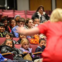 """120214  Adron Gardner/Independent<br /> <br /> Elementary students watch the University of New Mexico - Albuquerque Opera theater performance of """"The Trial of Goldilocks"""" at UNM in Gallup Tuesday."""