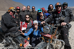 Group shot with some trekkers after riding across a narrow suspension bridge over the Kali Gandaki River on day-6 of our Himalayan Heroes adventure riding from Muktinath to Tatopani, Nepal. Sunday, November 11, 2018. Photography ©2018 Michael Lichter.