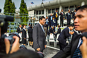 21 AUGUST 2014 - BANGKOK, THAILAND:       PORNPETCH WICHITCHOLCHAI, President of the Thai National Legislative Assembly (NLA) walks into the NLA's group photo before their meeting to select a new Prime Minster. The NLA was hand selected by the Thai junta, formally called the National Council for Peace and Order (NCPO), and is supposed to guide Thailand back to civilian rule after a military coup overthrew the elected government in May. The NLA unanimously selected General Prayuth Chan-ocha, commander of the Thai Armed Forces and leader of the coup in May that deposed the elected civilian government, as Prime Minister. Prayuth is Thailand's 29th Prime Minister since the 1932 coup that created Thailand's constitutional monarchy.    PHOTO BY JACK KURTZ