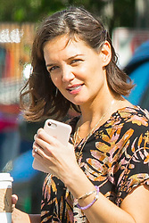 "EXCLUSIVE: ***NO WEB UNTIL 2PM EST NOV 1*** Katie Holmes wears a diamond engagement ring as she steps out for a coffee, but it seems she's not engaged to long-time boyfriend Jamie Foxx. A smiling Holmes looked relaxed and radiant as she openly flashed her bling as she went for a coffee with fellow actor Jerry O'Connell. Katie and Jerry co-star in a feature-film adaptation of the self-help best-seller 'The Secret.' The pictures were taken the day before filming started in New Orleans. But her publicist later insisted: ""Katie's not engaged to anyone besides her fictional movie fiancé, played by Jerry O'Connell."" Holmes, who divorced 'Top Gun' star Tom Cruise in 2012, was later spotted chatting happily with Foxx, who she's believed to have been dating for five years. Foxx is currently also in New Orleans filming his latest movie, 'Power,' co-starring Joseph Gordon-Hewitt. Foxx and Dawson's Creek alum Holmes looked very much in love - the word 'LOVE' was even written on Katie's handbag. Holmes had changed into a black and white jumpsuit before the two went for a evening shop at Michael's craft store - but the actress kept her hands firmly buried in her pockets, so it's not known if she was still wearing the 'prop' ring. Foxx, 50, and Holmes, 39, went pubslic in April during a PDA-packed beach outing on a Malibu beach after shying away from getting cozy together in public for years. The very private couple have reportedly been dating since being spotted dancing together at the Hamptons a year after the Dawson Creek star's highly-publicised separation from Cruise. They have taken extraordinary measures to keep their relationship secret amid claims Katie's ex-husband included a clause in her 2012 divorce settlement banning her from publicly dating for five years. The actress split from Top Gun superstar in 2012 after six years. Their romance was one the Hollywood's biggest headline makers after they got engaged in 2005 after just seven we"