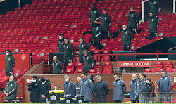 MANCHESTER, ENGLAND - Friday, January 1, 2020: Manchester United's manager Ole Gunnar Solskjær and his staff stand for a minutes' silence to remember former manager Tommy Docherty who died the day before, during the New Year's Day FA Premier League match between Manchester United FC and Aston Villa FC at Old Trafford. The game was played behind closed doors due to the UK government putting Greater Manchester in Tier 4: Stay at Home during the Coronavirus COVID-19 Pandemic. (Pic by David Rawcliffe/Propaganda)