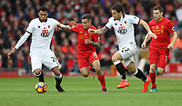 Football - 2016 / 2017 Premier League - Liverpool vs. Watford<br /> <br /> Philippe Coutinho of Liverpool goes past Daryl Janmaat of Watford and Etienne Capoue of Watford during the match at Anfield<br /> <br /> COLORSPORT/LYNNE CAMERON