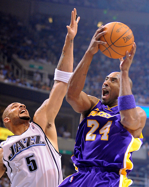 Utah's Carlos Boozer defends the Lakers' Kobe Bryant during the first half of Game 3 in Salt Lake City....///ADDITIONAL INFO:  lakers.0424.kjs4.jpg  ---  Photo by Kevin Sullivan, The Orange County Register --  ..The Los Angeles Lakers take on the Utah Jazz in Game 3 of the Western Conference Playoffs at EnergySolutions Arena in Salt Lake City, Utah...Photographed Thursday April 23, 2009 at Staples Center..