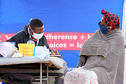 ALEXANDRA SOUTH AFRICA - APRIL 25: Residents with health workers during intensified testing and screening on Freedom Day, screening and testing includes people over over 60, flu-like symptoms, comorbid conditions, like diabetes, asthma, hypertencsion, HIV and tuberculosis on April 25, 2020 in Alexandra South Africa. Under pressure from a global pandemic. President Ramaphosa declared a 21 day national lockdown extended by another two weeks, mobilising goverment structures accross the nation to combat the rapidly spreading COVID-19 virus - the lockdown requires businesses to close and the public to stay at home during this period, unless part of approved essential services. (Photo by Dino Lloyd)